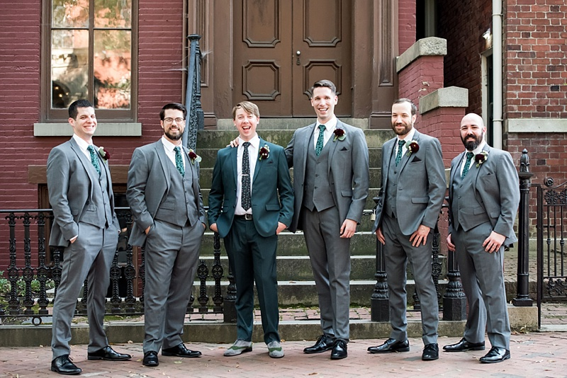 Dapper groomsmen in three piece gray suits to complement the groom in his emerald green suit for vintage modern wedding in Richmond Virginia