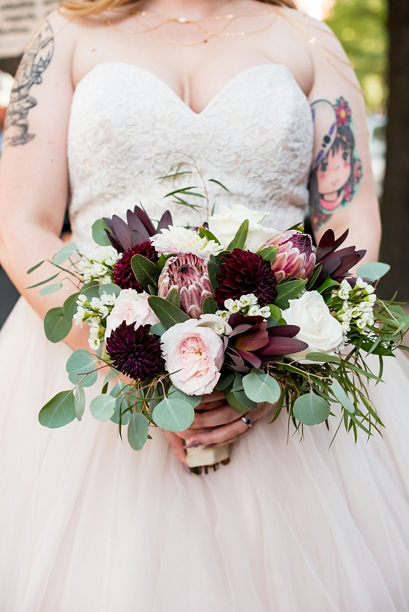 Gorgeous medium sized fall jewel toned bridal bouquet with dark red proteas and dahlias for a vintage modern wedding on Virginia wedding blog