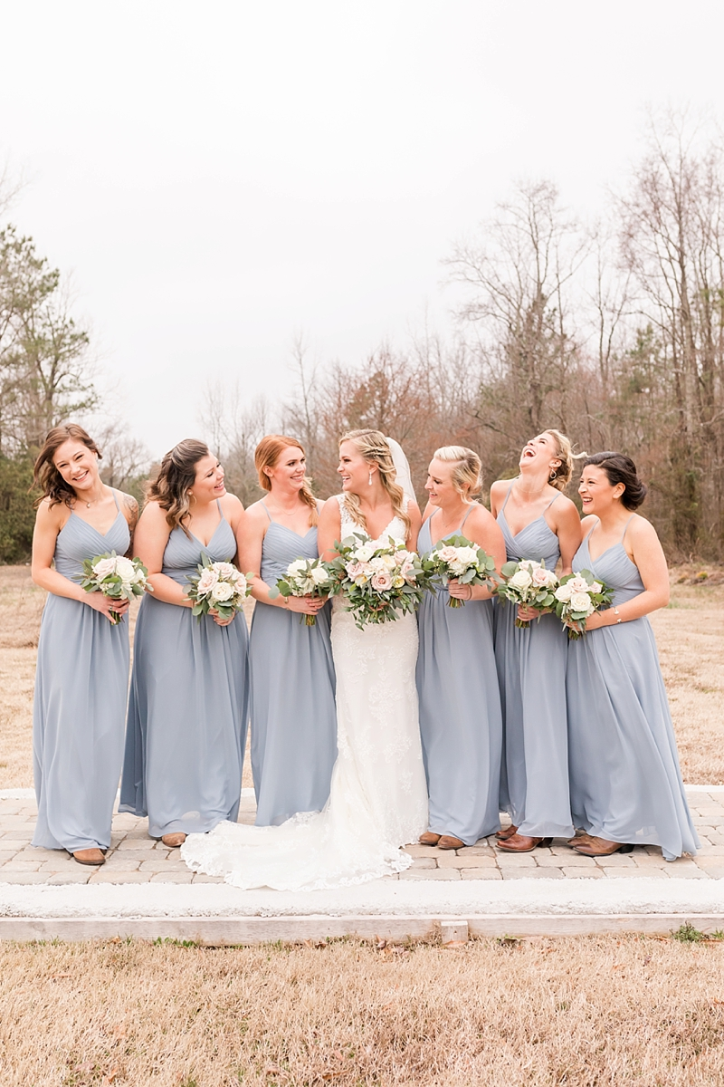 Bridesmaids in light blue dresses for rustic barn wedding in Virginia