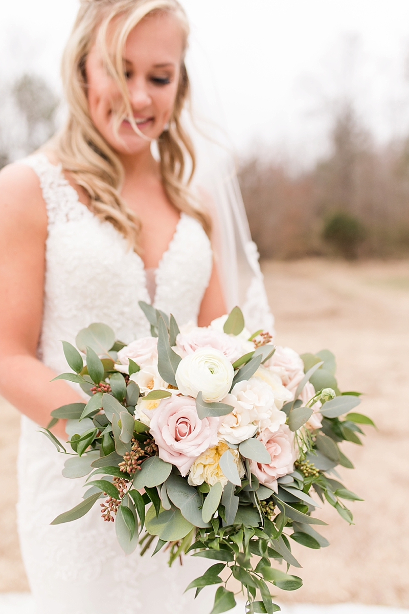 Bridal bouquet with roses and eucalyptus for rustic wedding