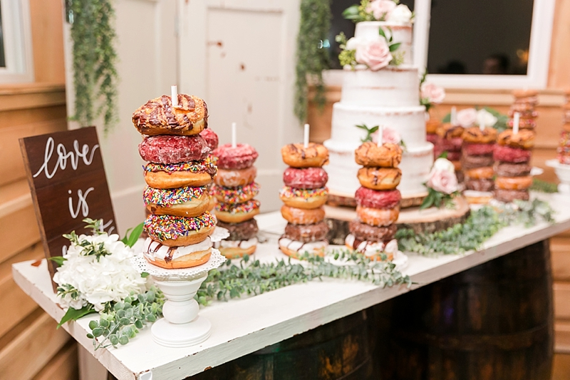 Yummy dessert bar with donuts and wedding cake