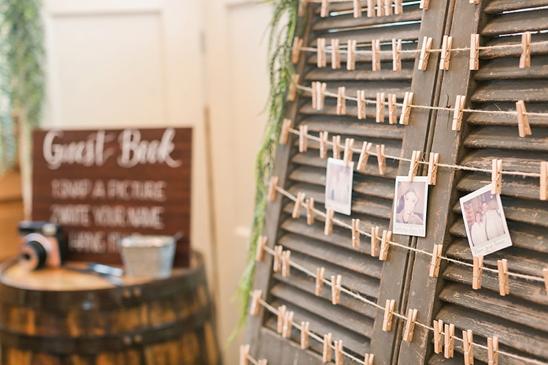 Unique wedding guest book idea with clothespins and wooden shutters