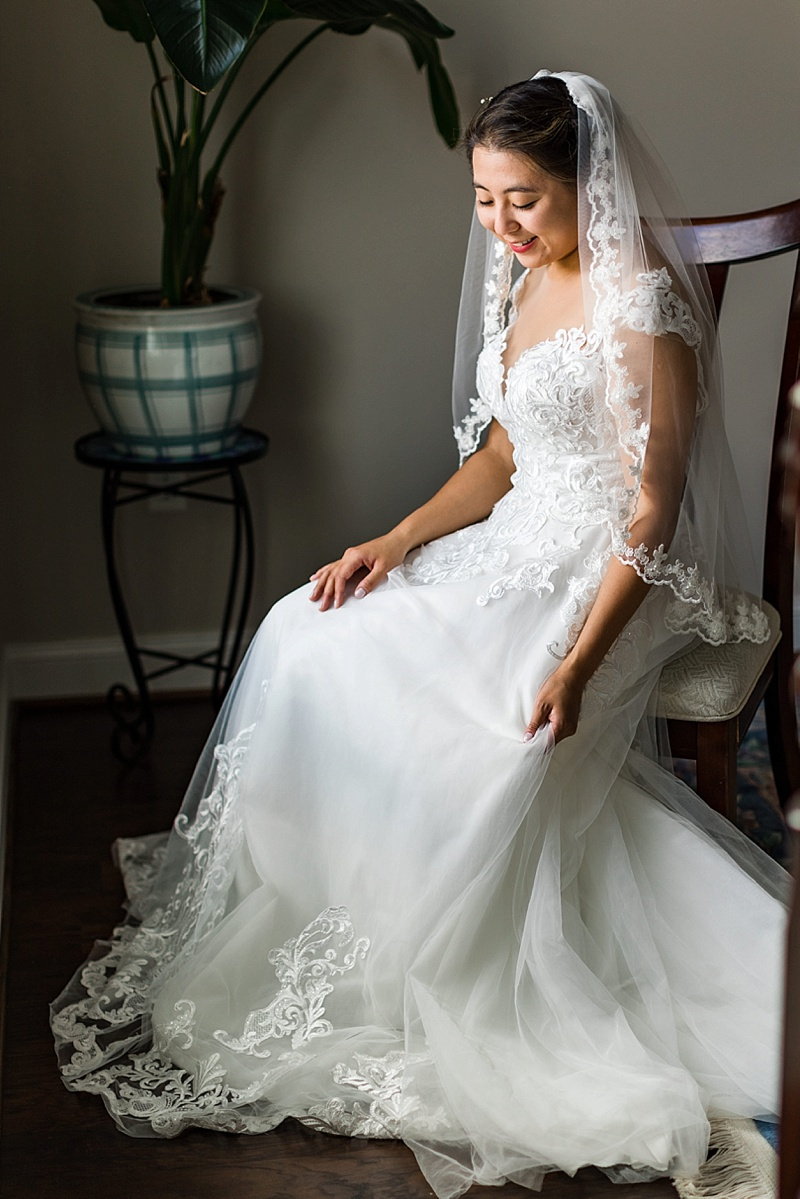 Timeless bridal portrait of bride in her Eddy K wedding dress with embroidered details and coordination wedding veil