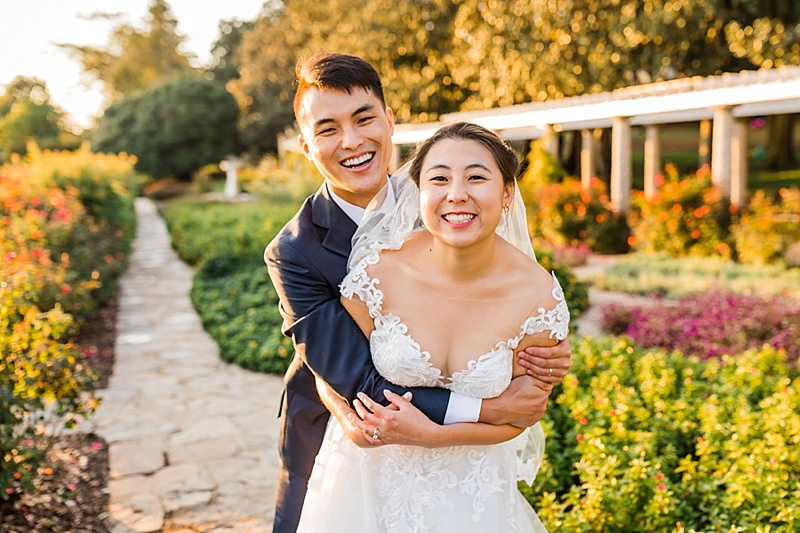 Bride and groom hug after their wedding ceremony at Maymont in Richmond Virginia