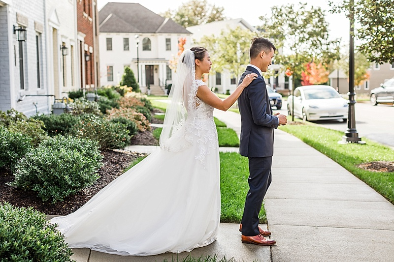 First look moment between bride and groom at their home in Richmond Virginia