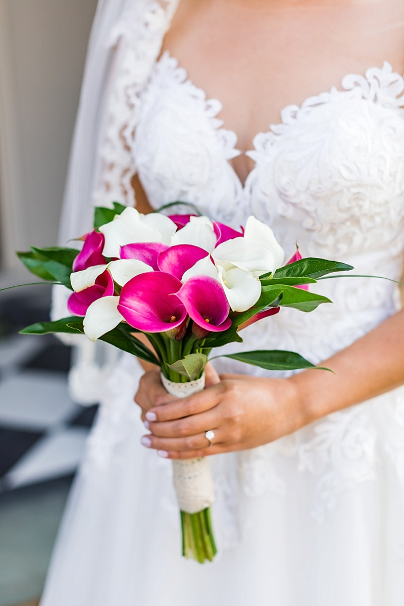 Simply tied bridal bouquet of white and magenta pink calla lilies for intimate wedding
