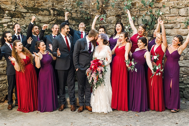 Excited wedding party in gray suits and gorgeous purple plum bridesmaid dresses for fall vintage wedding at Mill at Fine Creek in Powhatan Virginia