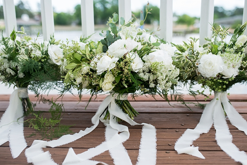 Textured green and white wedding bouquets filled with fern and roses