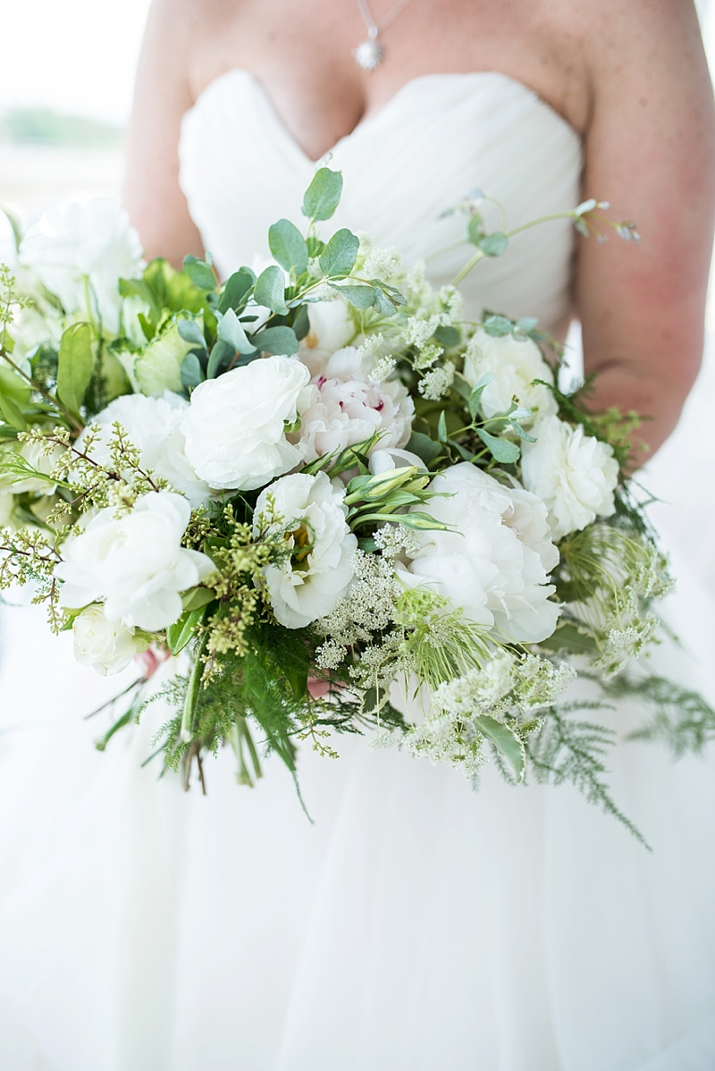 Gorgeous lush white wedding bouquet with peonies and greenery for modern rustic bride