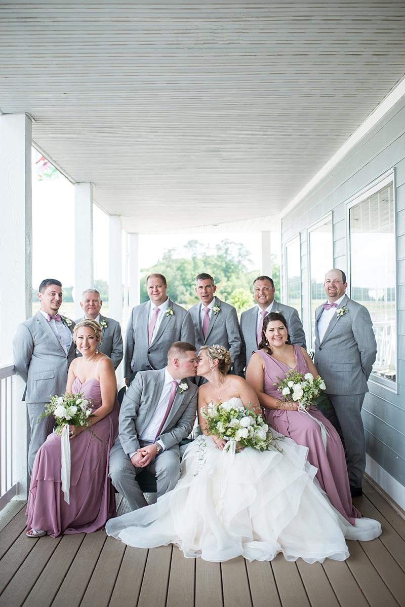 Gray groomsmen suits and pink bridesmaid dresses for modern rustic wedding in Smithfield Virginia