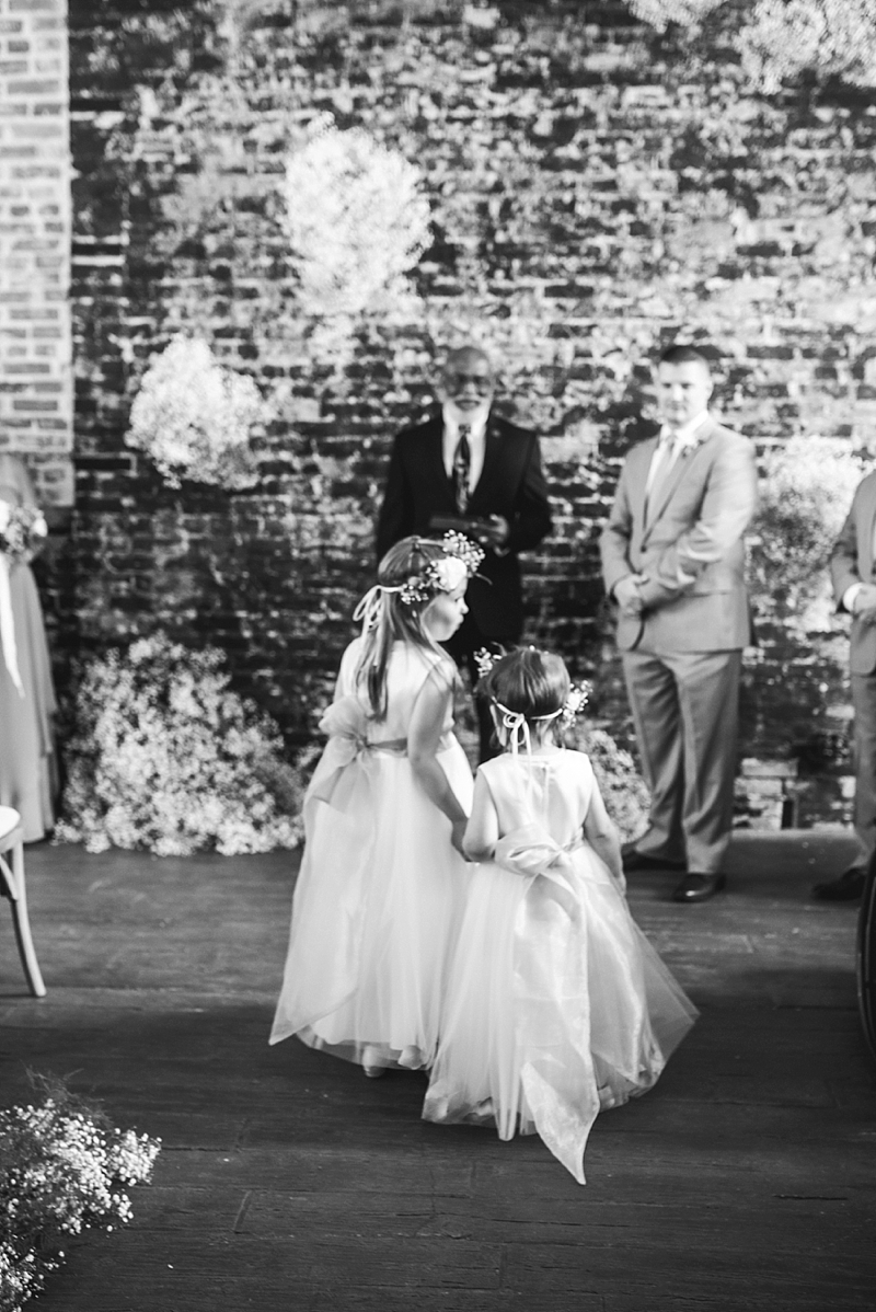 Adorable flower girls wearing flower crowns for indoor rustic wedding ceremony