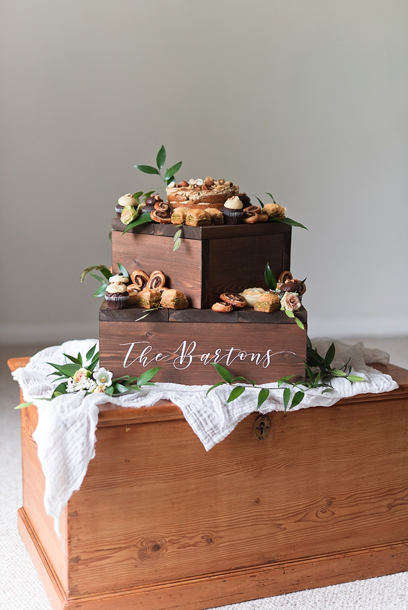 Chic dark wooden wedding cake box stands for desserts and that can be personalized and upcycled into plant stands after the event