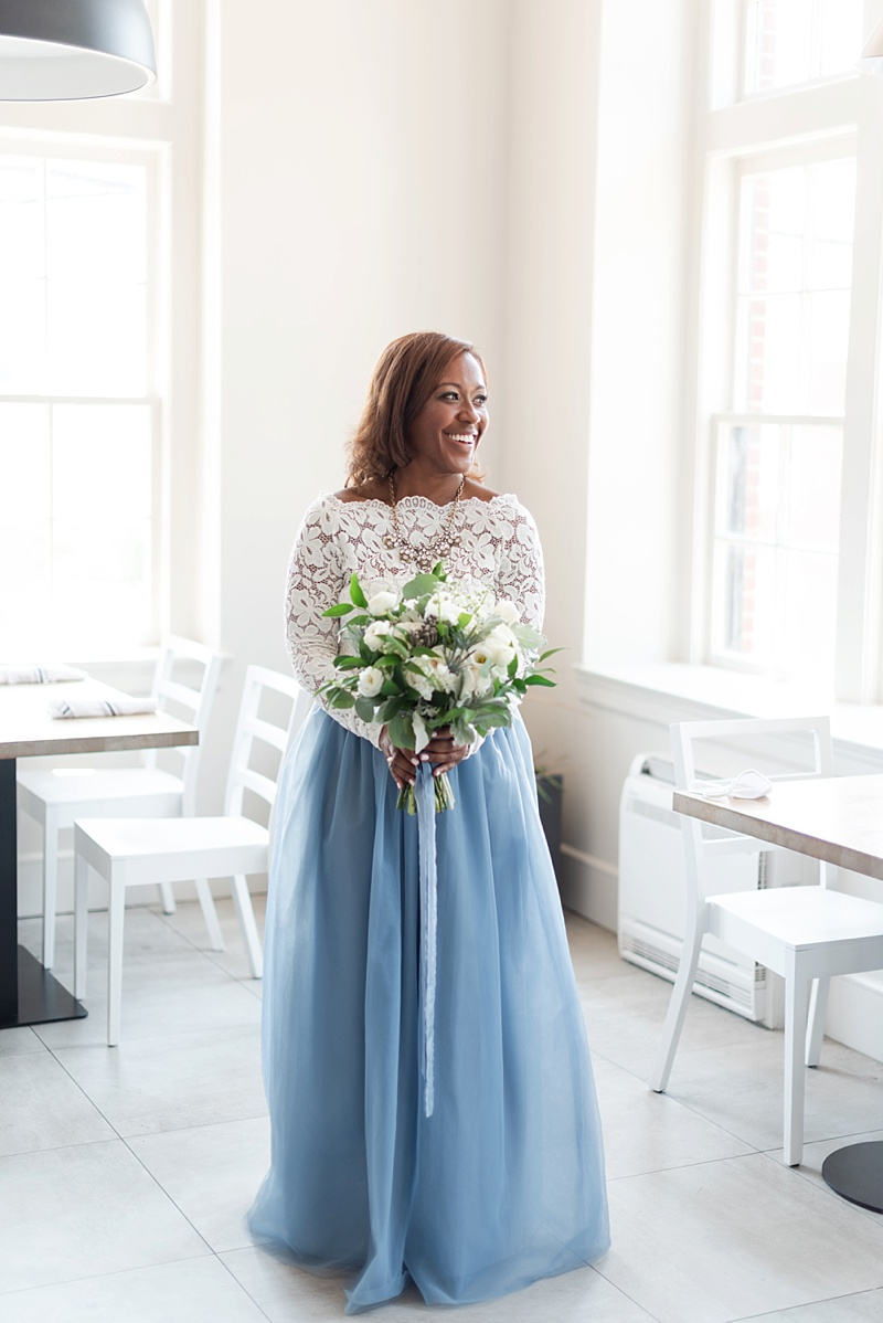 Beautiful Black bride wearing a blue wedding tulle skirt and a lace top for a unique elopement outfit idea