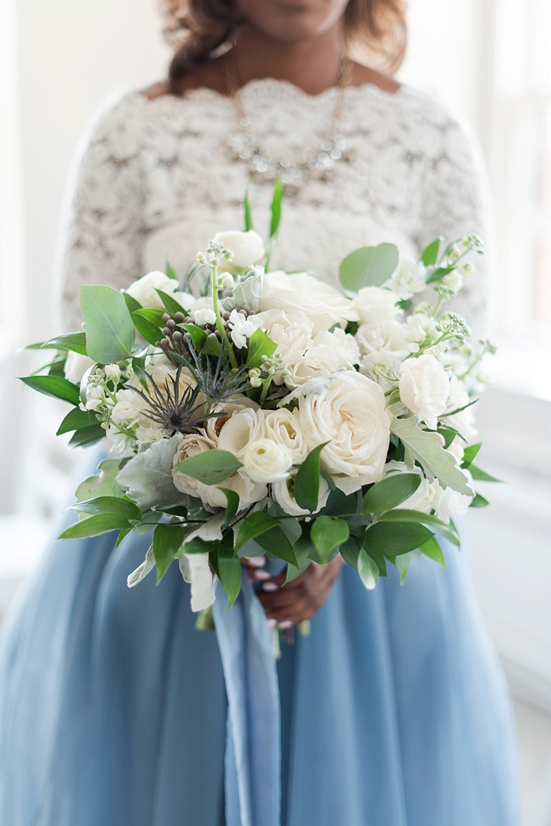 All white wedding bouquet filled with roses and greenery perfect for an elopement in Virginia