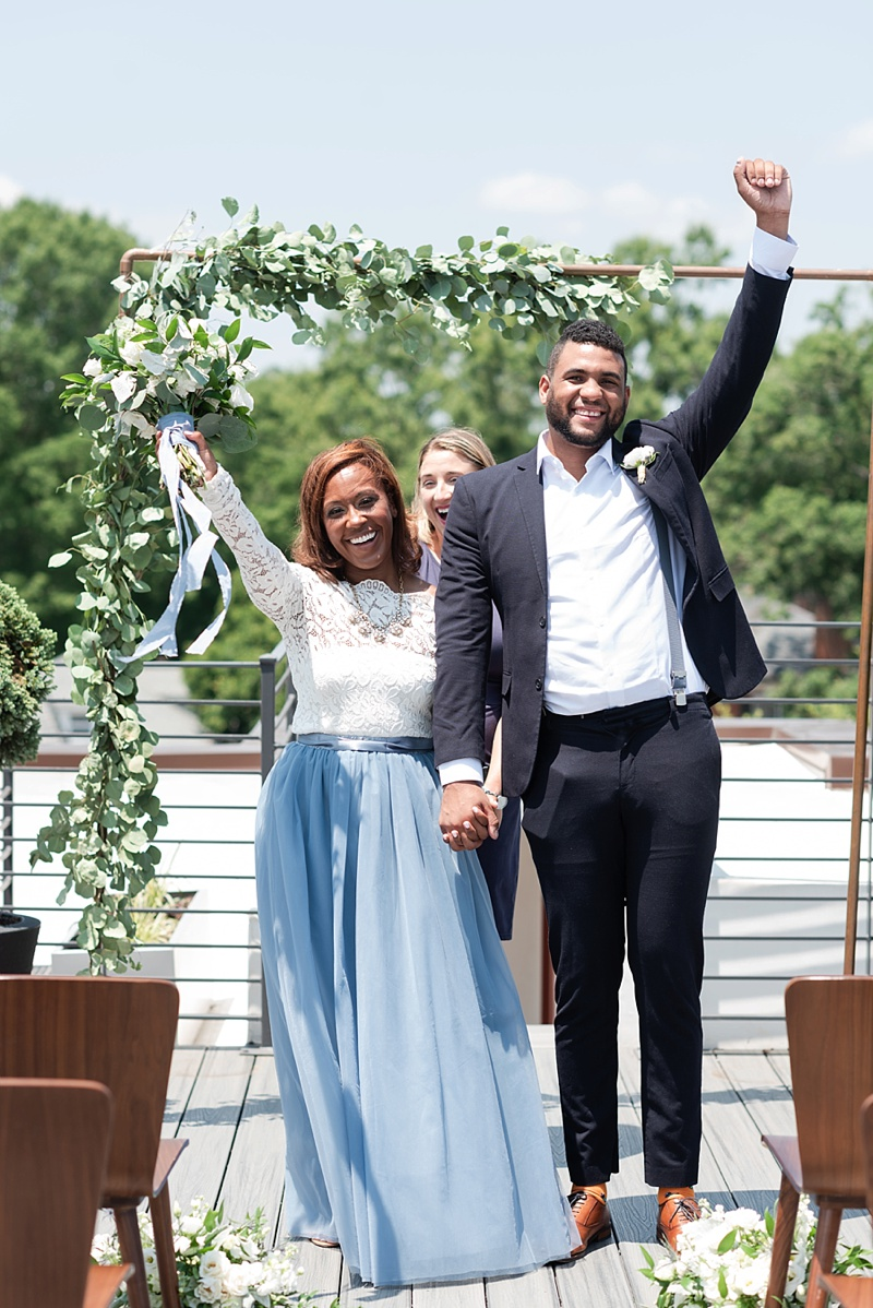 Rooftop outdoor wedding elopement ceremony with copper arch and floral swag at Hotel Weyanoke in Farmville Virginia