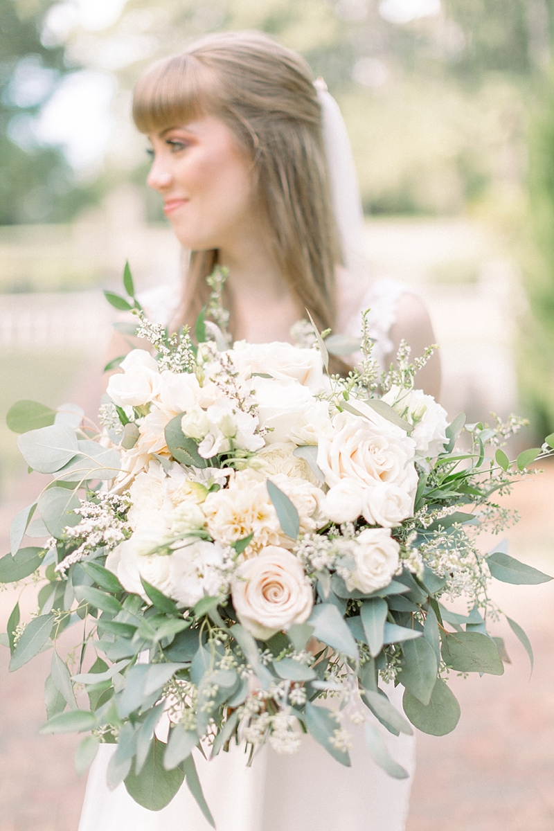 Large wedding bouquet with eucalyptus and roses for a timeless garden wedding at Norfolk Botanical Garden in Virginia