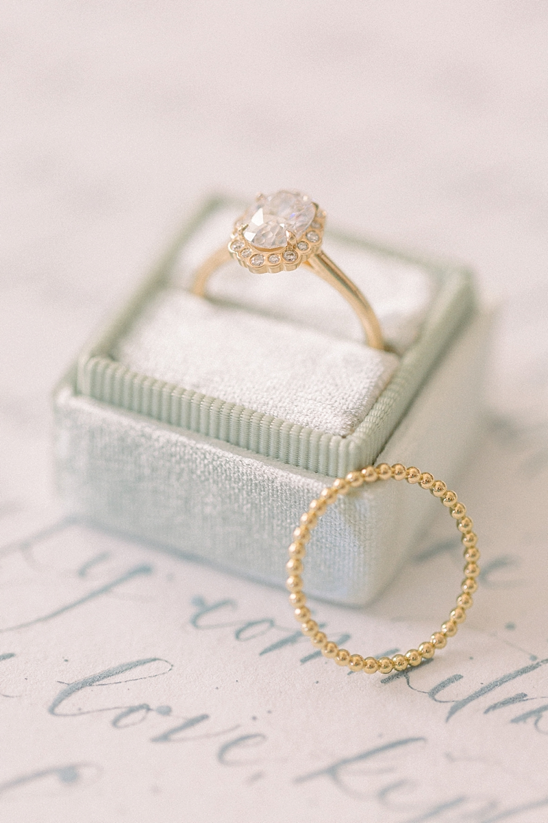 Unique and timeless diamond solitaire engagement ring and beaded gold wedding band for a classic garden wedding couple