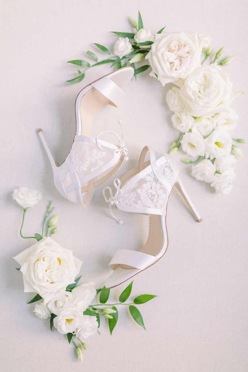 Elegant white bridal heels with lace tie details for classic bride having a garden wedding at Norfolk Botanical Garden in Virginia