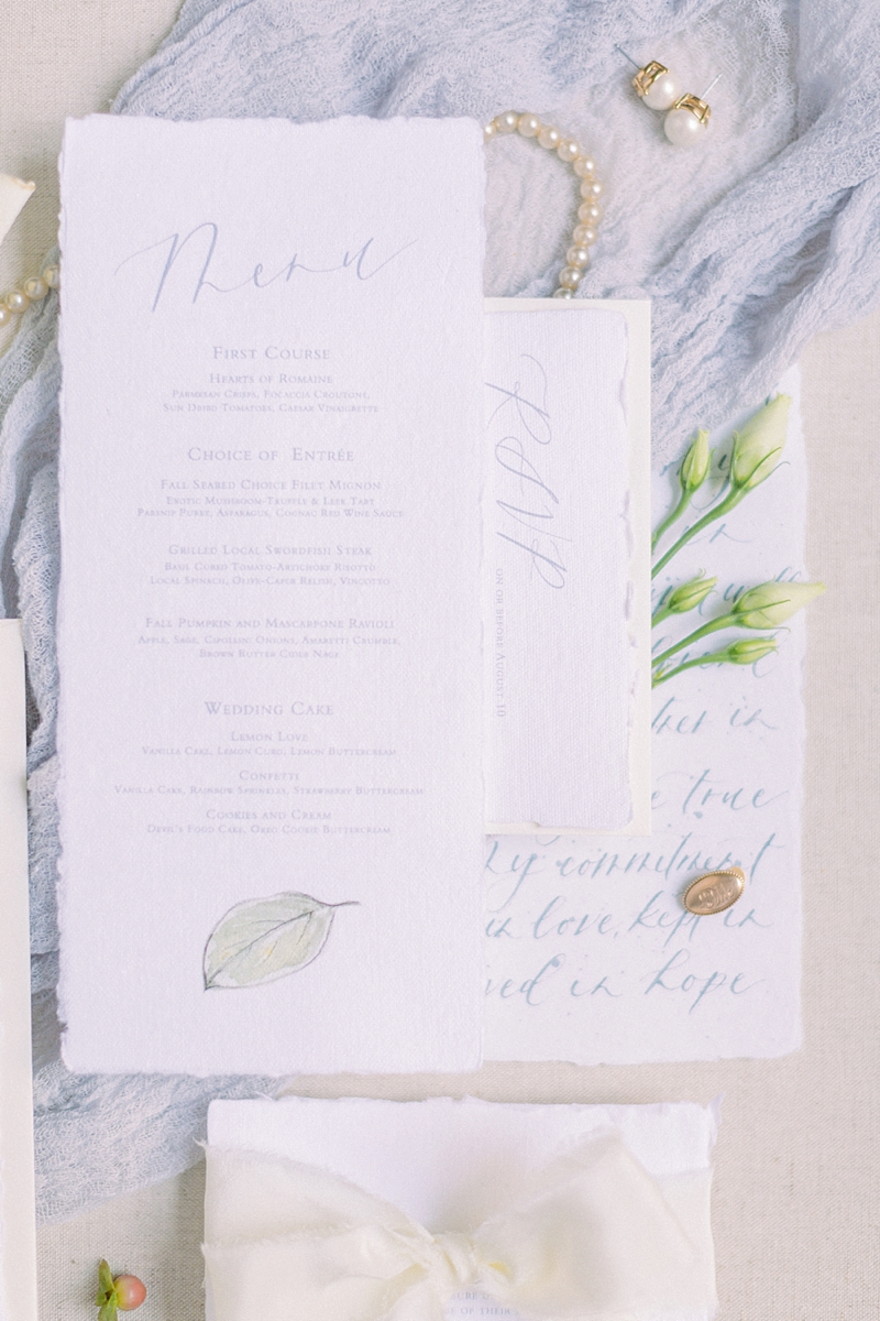 Soft blue wedding menu stationery with calligraphy and fine art flower illustration