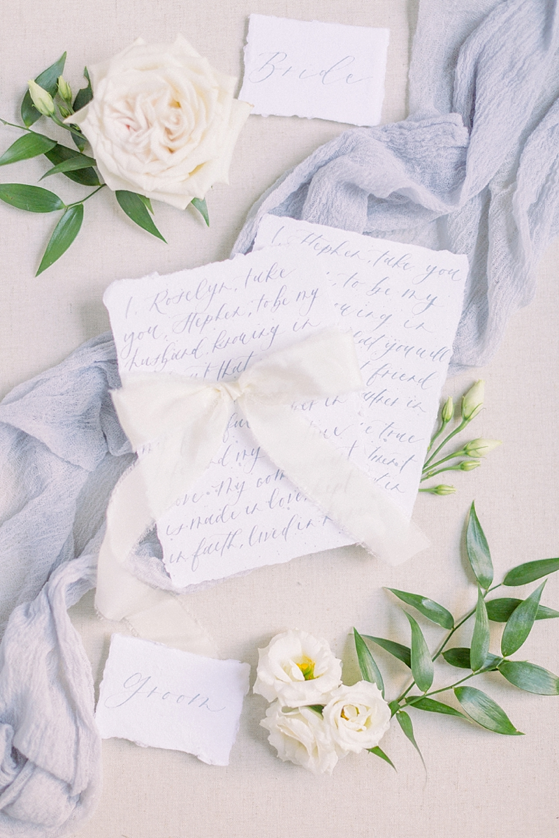 Handwritten calligraphy wedding vows in light blue ink on handmade cotton paper for classic wedding idea