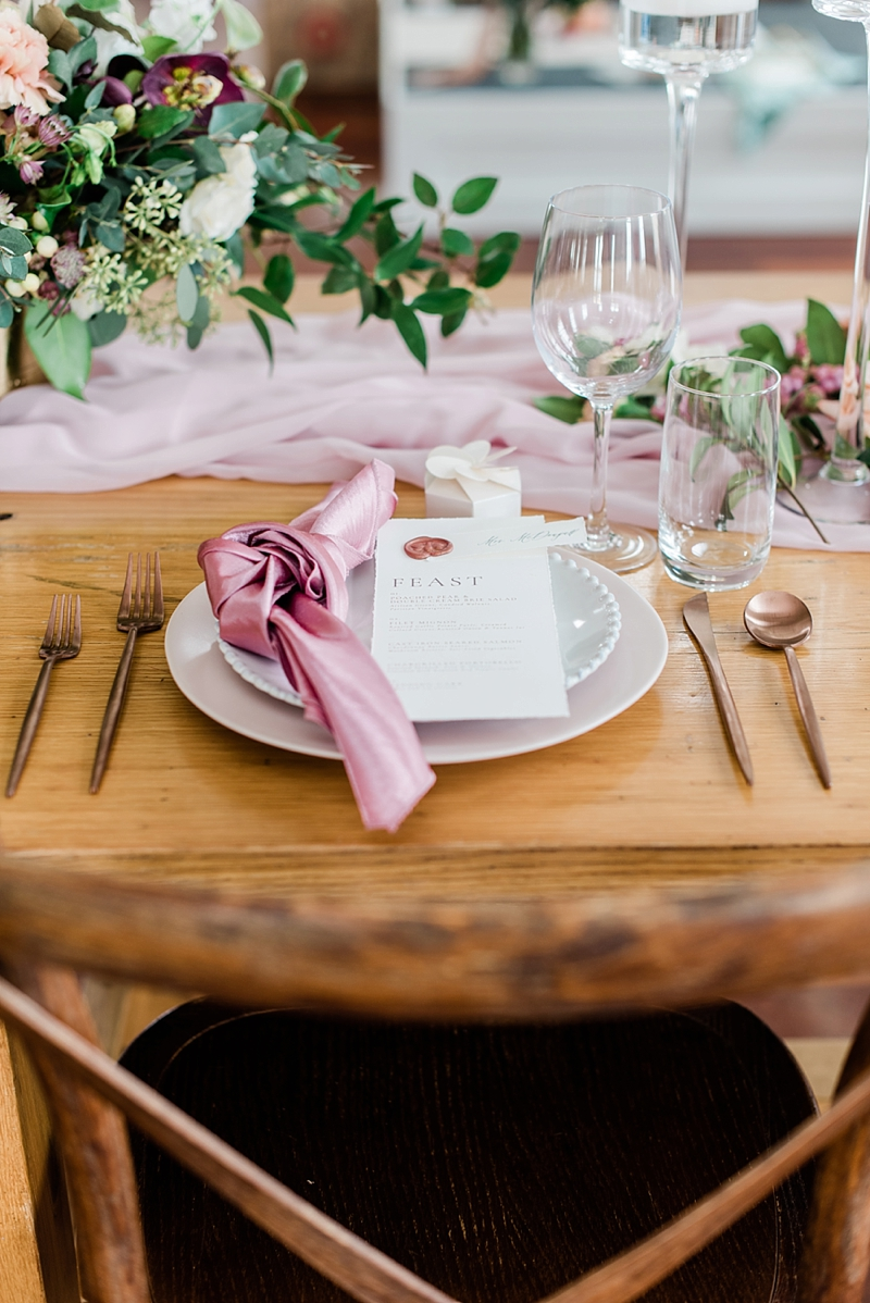 Copper flatware and knotted pink napkin and menu card for beautiful wedding place setting ideas