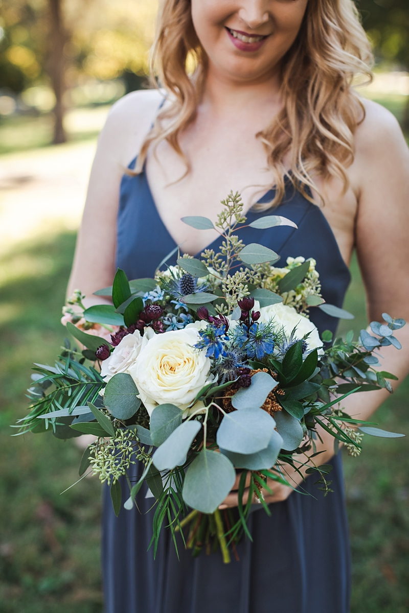 Textured bridesmaid bouquet with eucalyptus and purple red flowers for classic rustic wedding