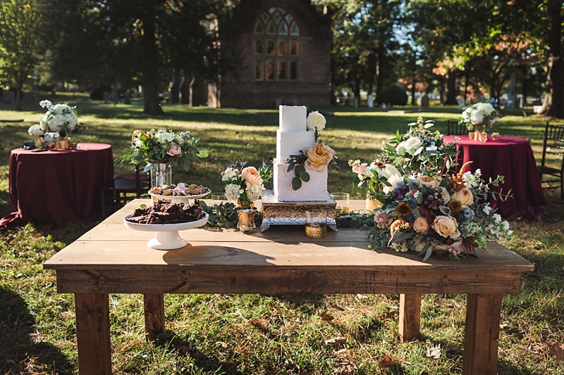 Beautiful wedding dessert bar with homemade treats like cannoli and brownies for a rustic classic wedding