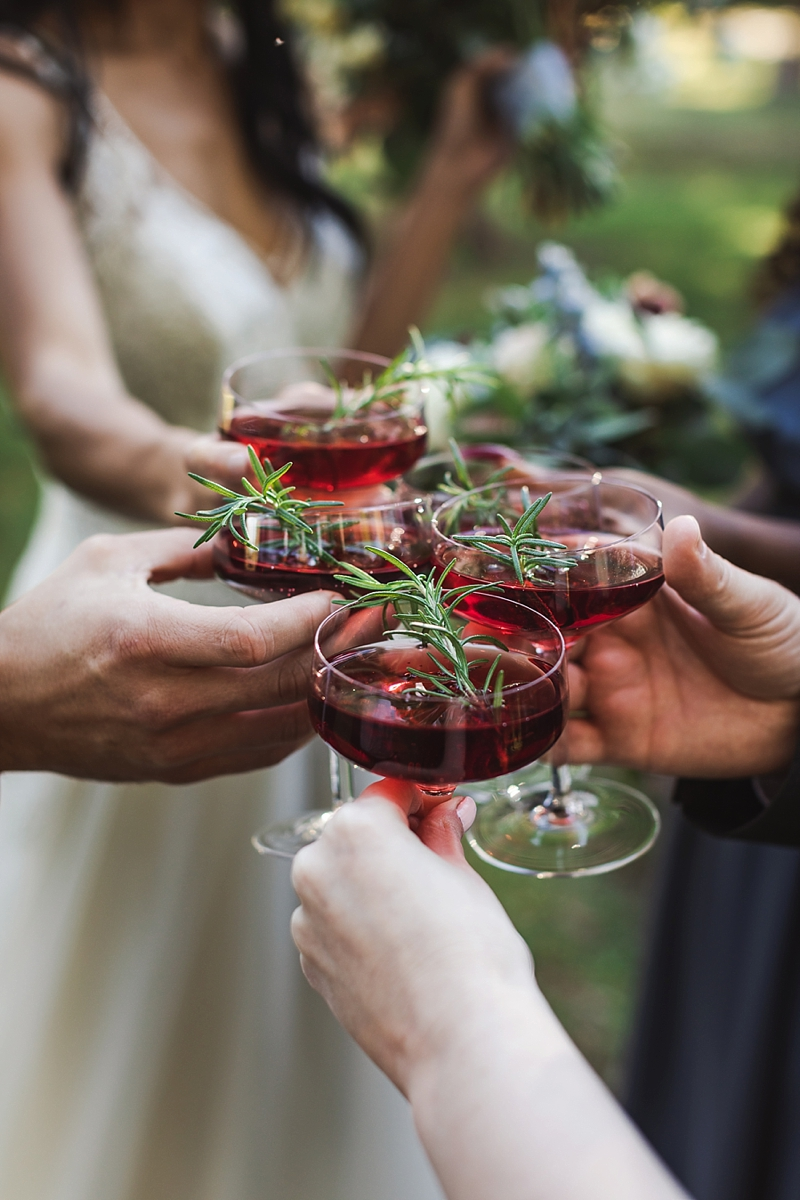 Dark red wedding cocktail ideas with rosemary sprigs for a classic rustic wedding reception in Virginia