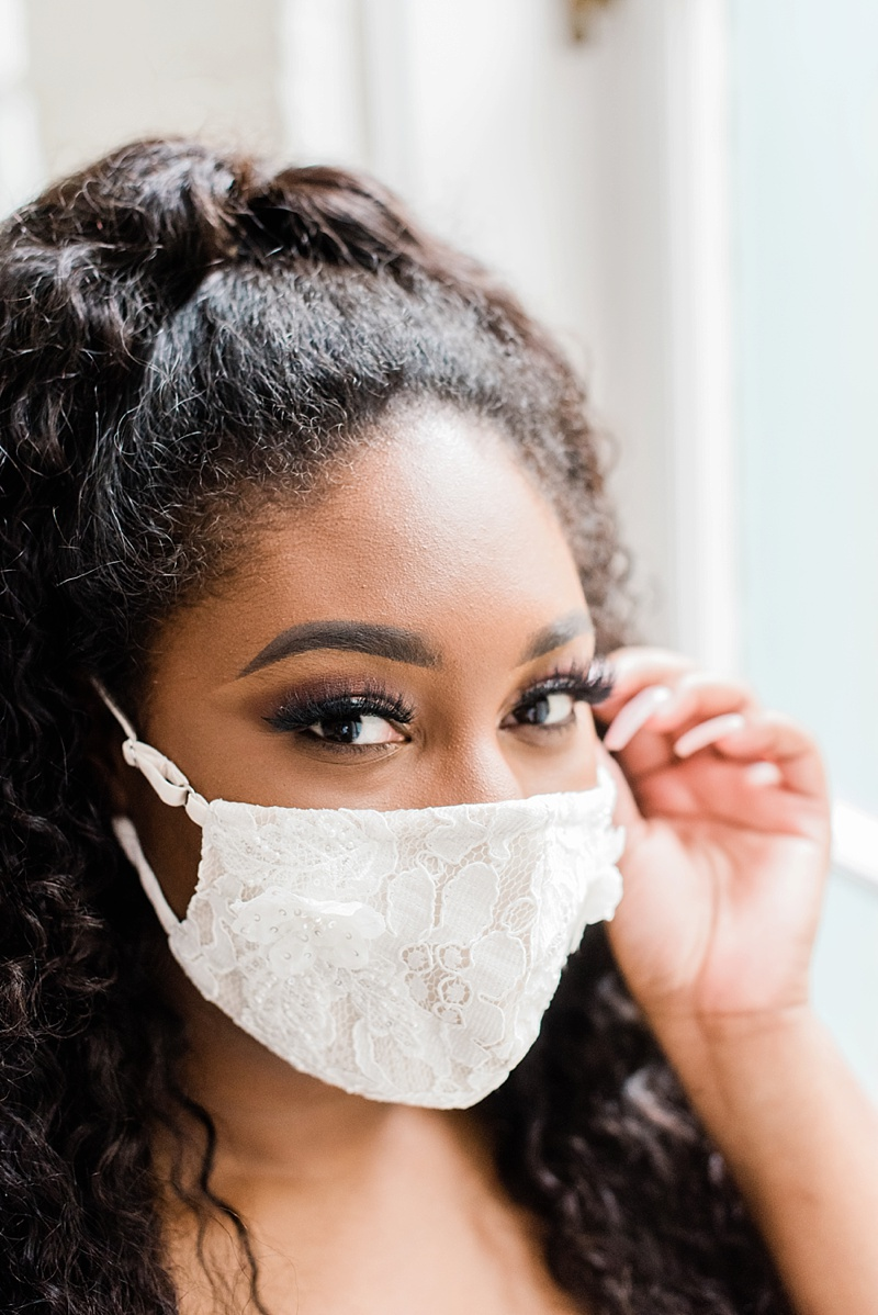 Beautiful Black bride with bridal lace face mask