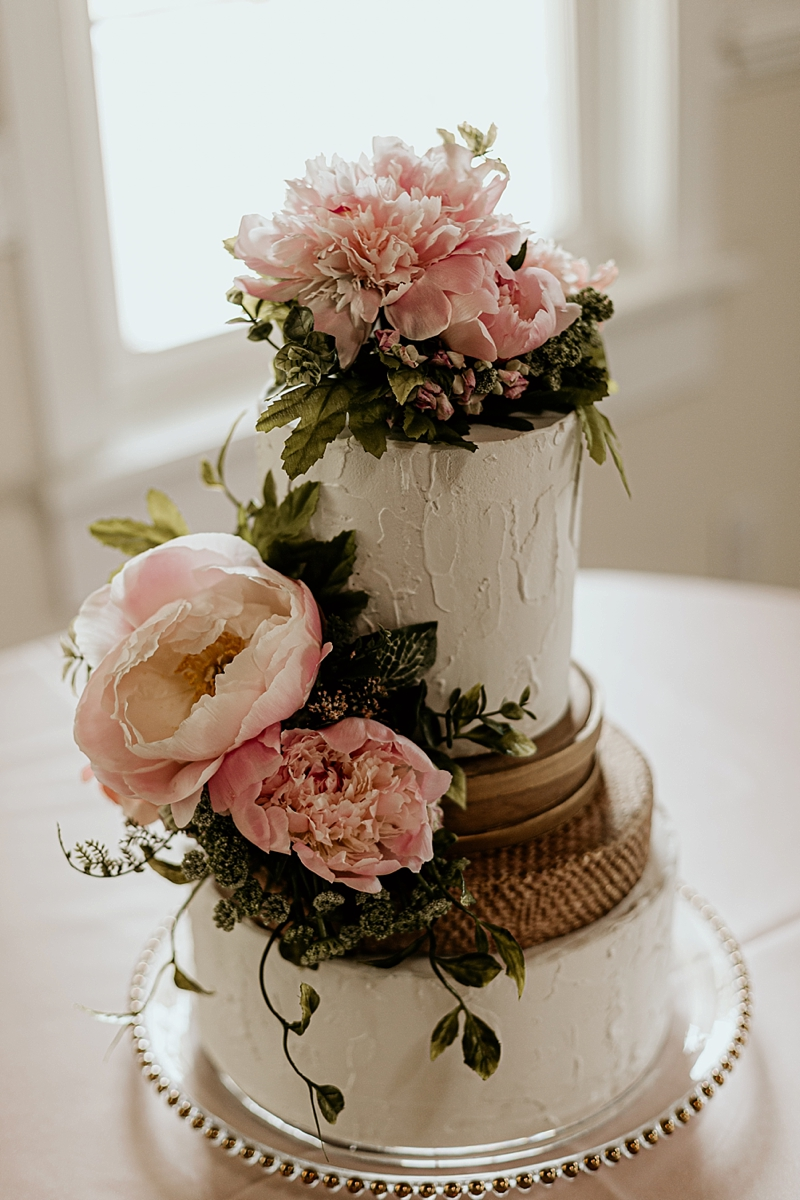 Wildly romantic wedding cake with rustic flower layers and textured buttercream