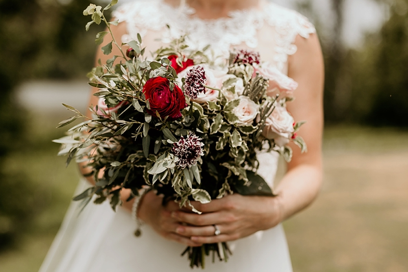 Wild romantic wedding bouquet with anemones and red flowers