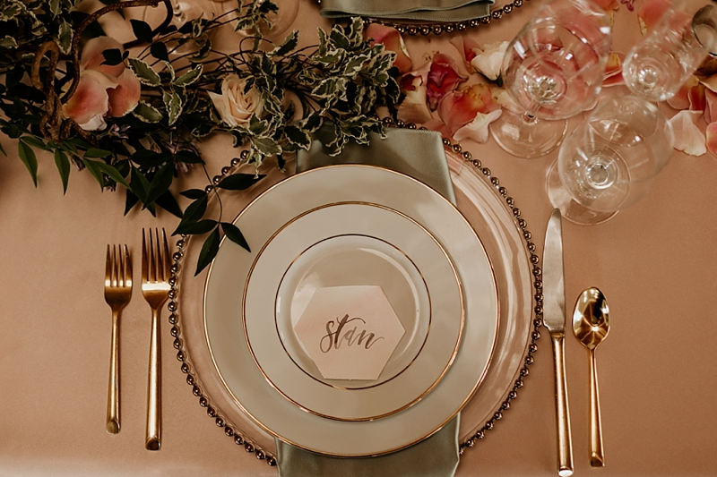 Rustic glam wedding table setting with gold and pink geometric hexagon watercolor place card