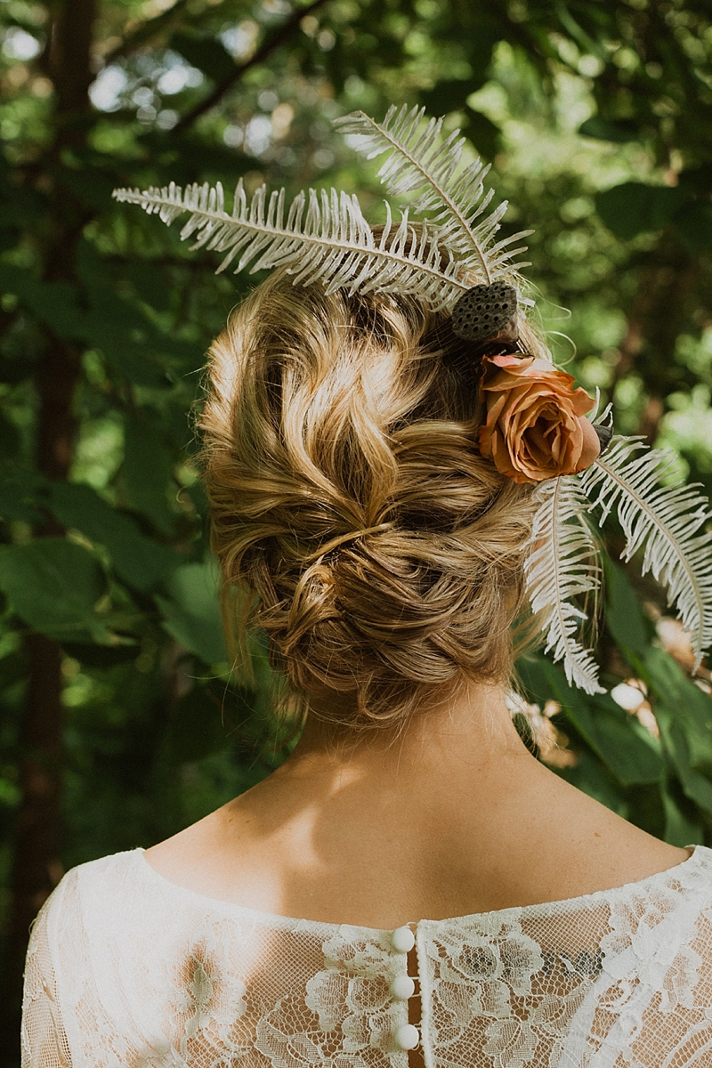 Gorgeous boho bridal hairpiece with dried fern and lotus pods for a relaxed wedding