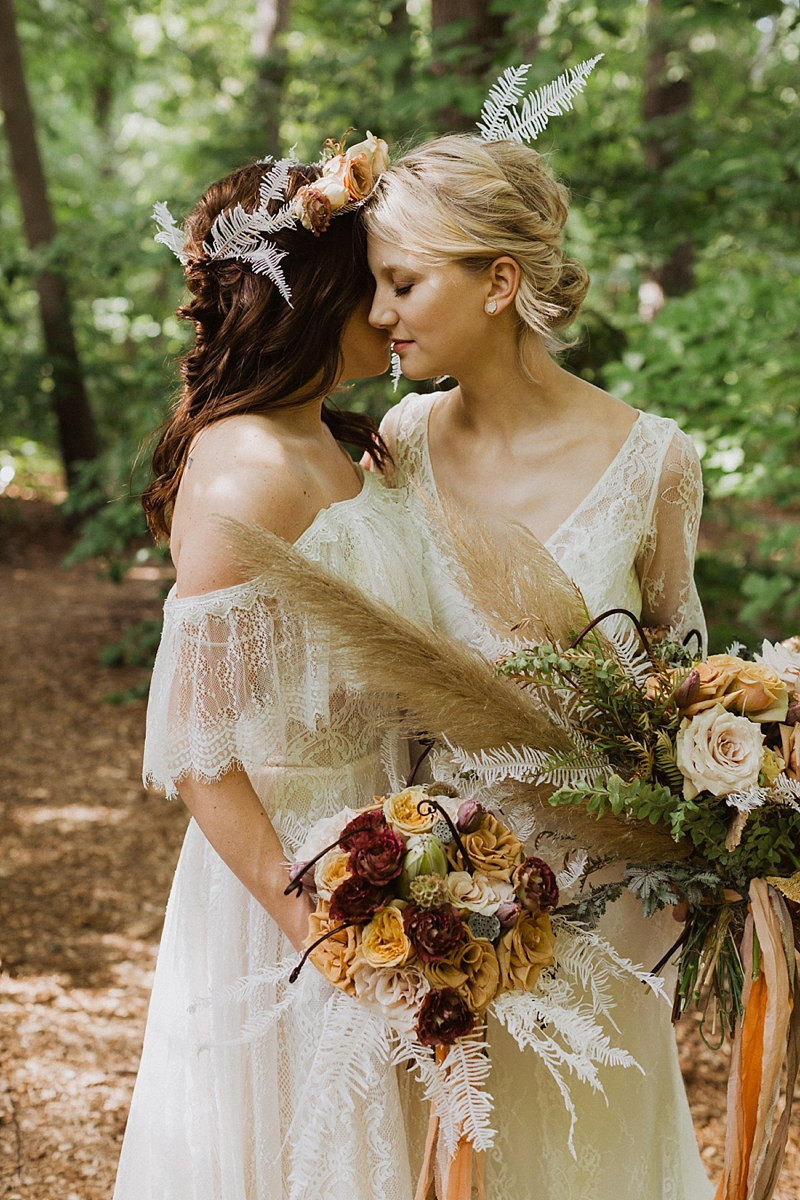 Romantic boho forest wedding inspiration for lesbian brides with bouquets of pampas grass and bleached fern