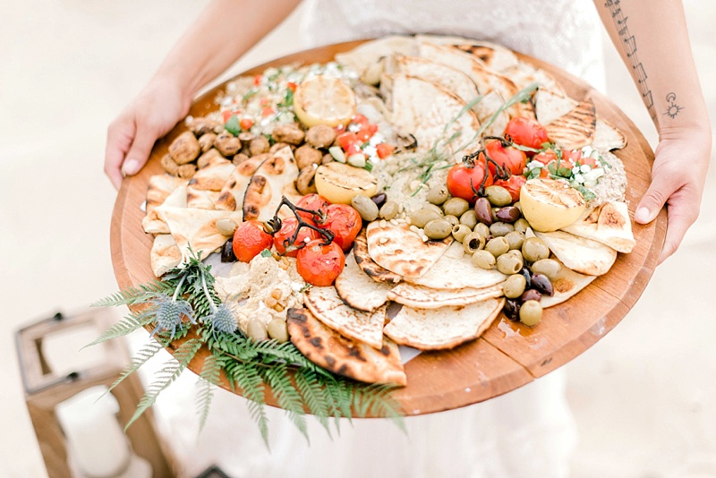 Beautifully plated mezza board with hummus and olives for a unique wedding grazing table