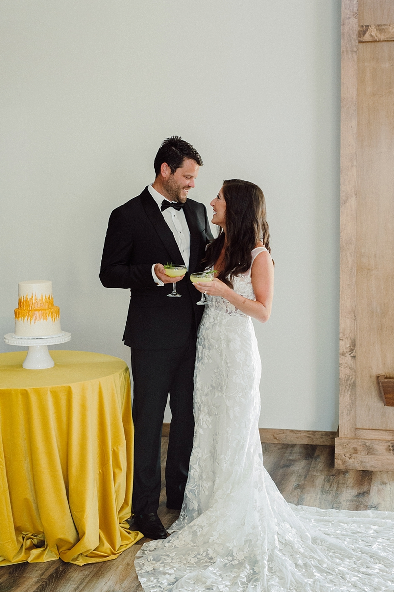 Bride and groom sharing a signature cocktail at Haven on the Banks at Keepers Gallery in Outer Banks