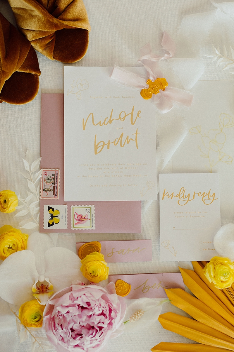 Modern boho wedding invitation suite with yellow ink and hand lettered calligraphy