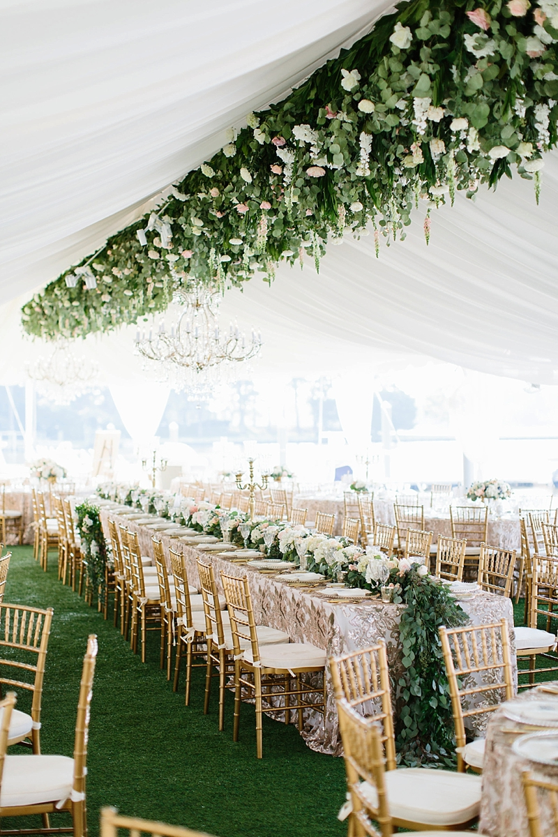 Gorgeous suspended florals for an elegant tented wedding reception by Virginia Beach wedding florist