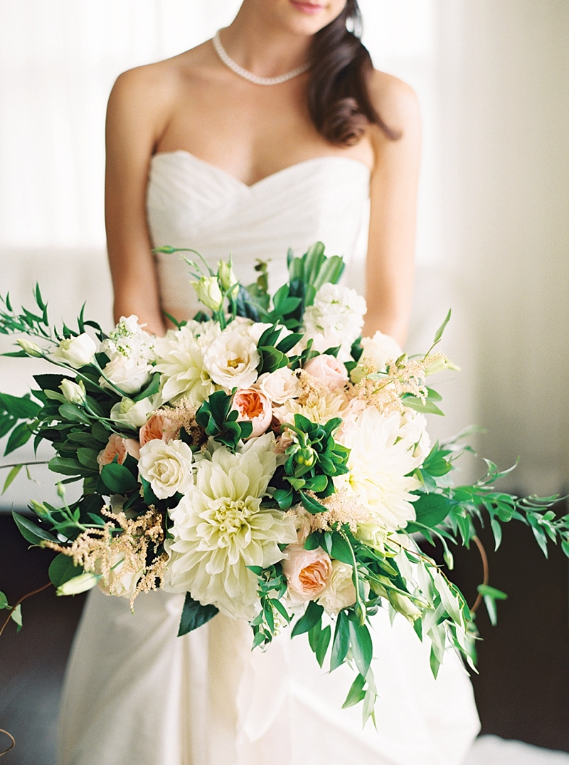 Lush and organic overflowing bridal bouquet with pink and white flowers perfect for a timeless Virginia wedding