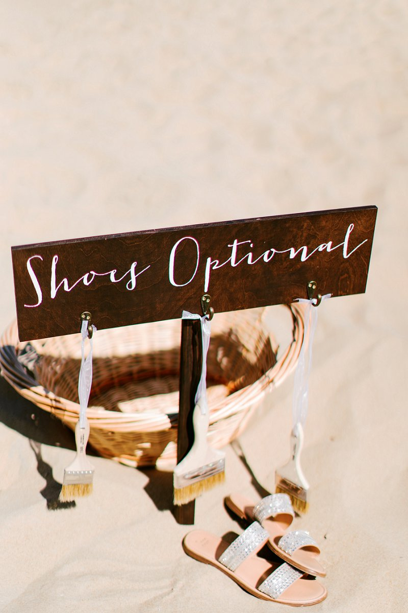 Chic Shoes Optional wedding sign with paintbrushes for a beach wedding ceremony