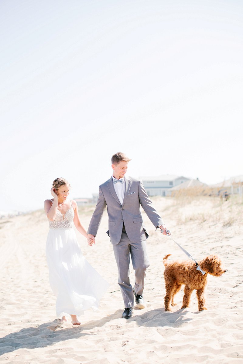 Beautifully classic Virginia Beach wedding with adorable wedding puppy in a bow tie