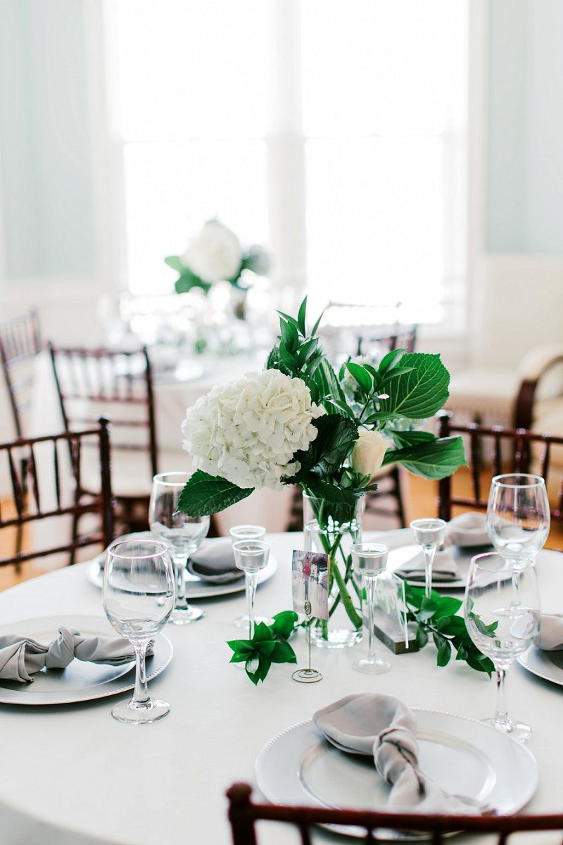 Simple white hydrangea centerpieces for beach house wedding in Virginia