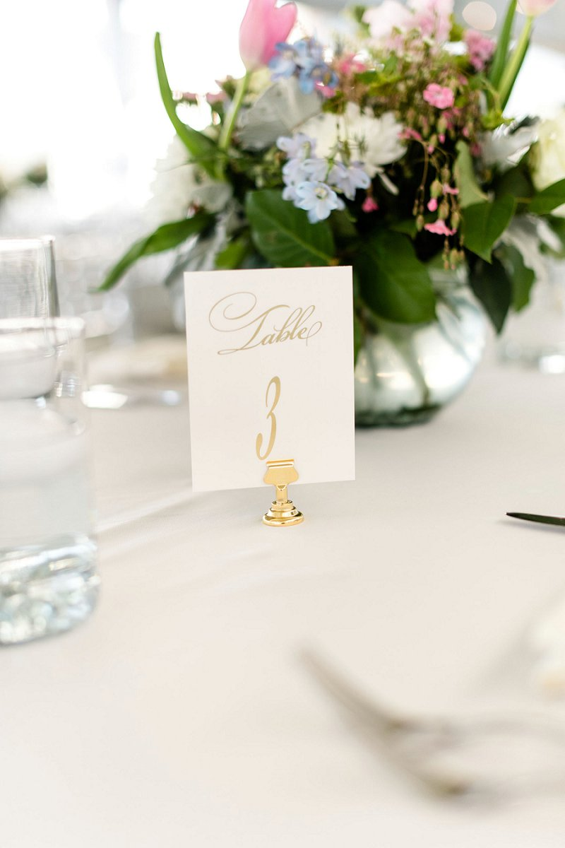 Classic gold calligraphy for simply elegant wedding table numbers on a golden stand