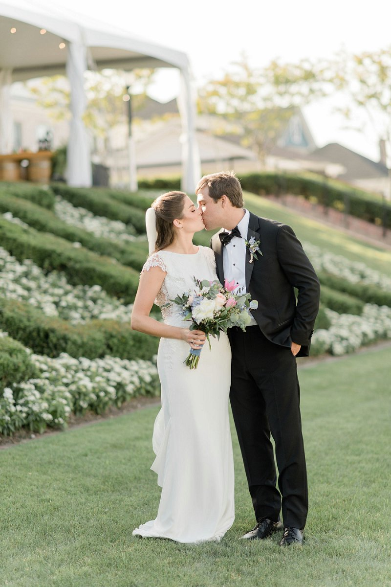 Romantic classic wedding at Cavalier Hotel in Virginia Beach with a bride in lace bridal gown and a groom in a black tie tuxedo