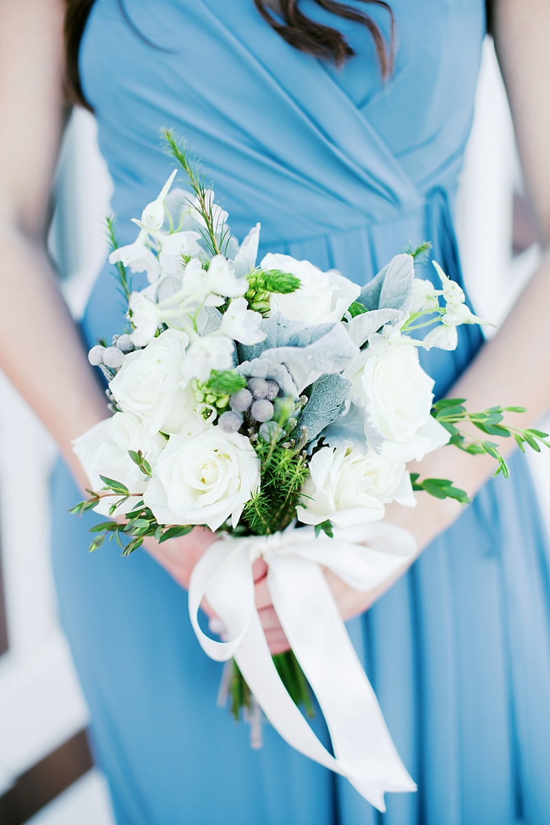 White and green bridesmaid bouquet with dusty miller for blue beach wedding