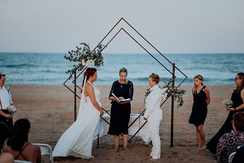 Gorgeously handmade modern geometric wedding arch for beach ceremony in Virginia Beach for two brides saying I Do