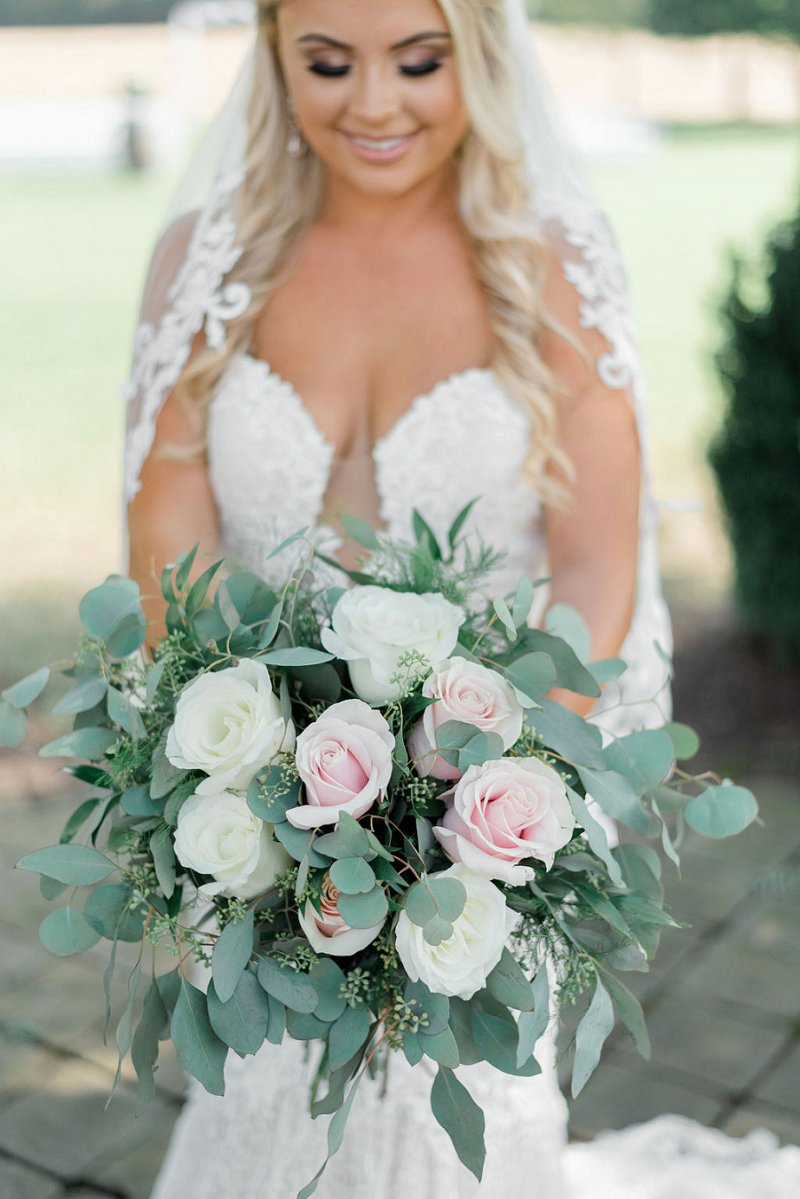 Classic rustic bridal bouquet with pink and white roses and lots of eucalyptus