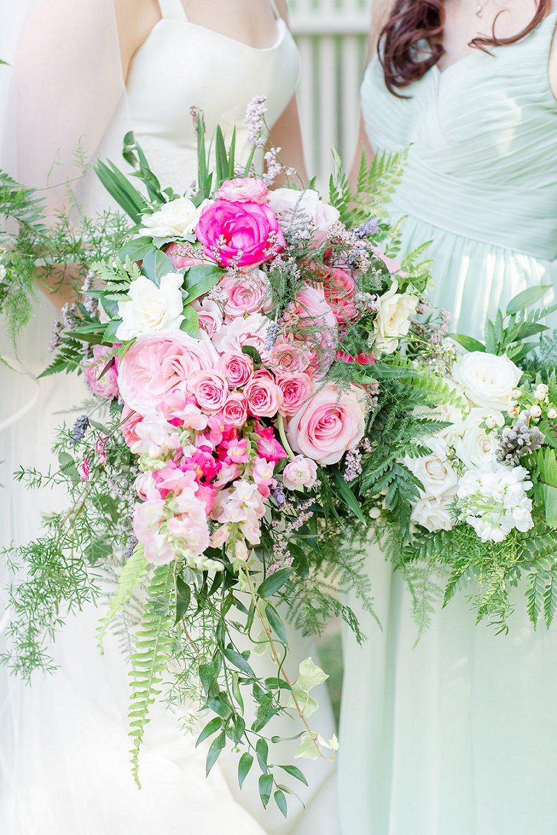 Gorgeous cascading bridal bouquet with giant pink flowers and wild greenery fern for summer wedding ideas