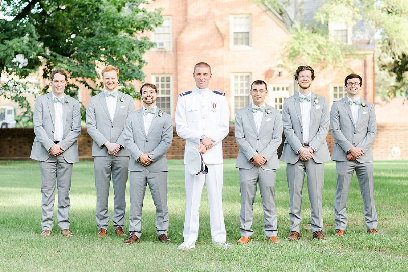 Military groom and his groomsmen in gray suits and mint green bow ties for a William and Mary wedding ceremony