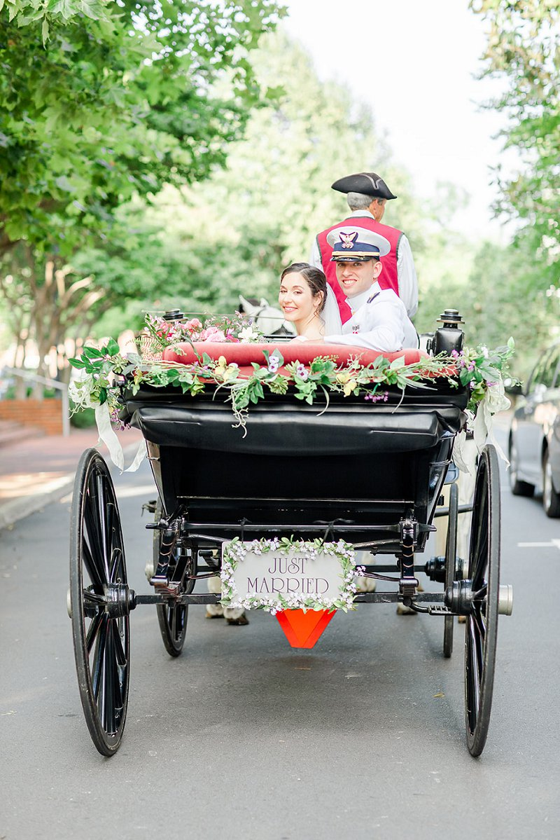 Romantic horse drawn carriage with floral swag and Just Married sign for historic Williamsburg Virginia military wedding